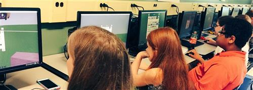 Students learning game design while